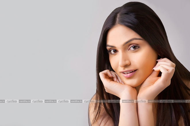 stock-photo-portrait-of-pretty-young-indian-woman-with-long-hair-isolated-over-colored-background-284216390
