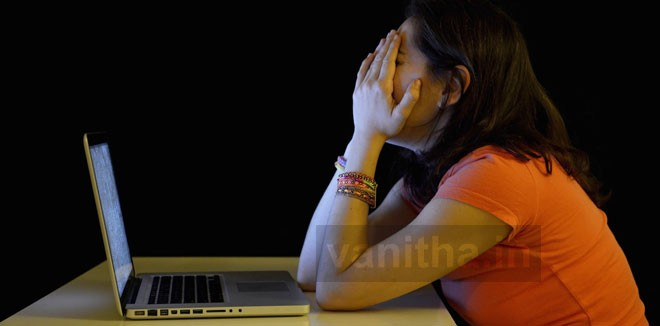 Young student woman alone at desk with computer crying desperate suffering