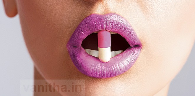 sexy female mouth with pill