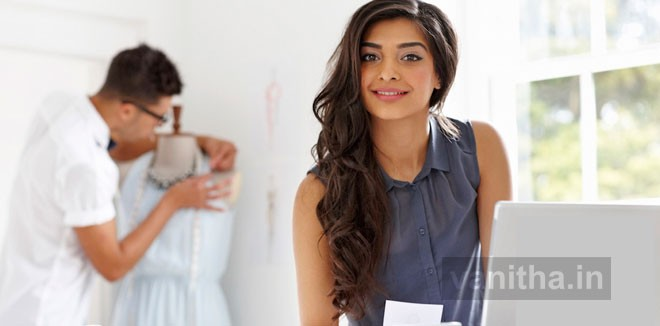 Young woman fashion designer working at studio