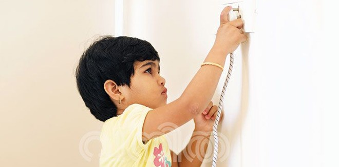 child trying to plug into socket