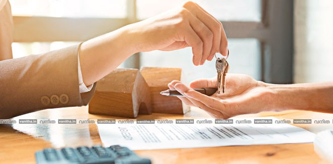 stock-photo-estate-agent-giving-house-keys-to-man-and-sign-agreement-in-office-657530335-(1)